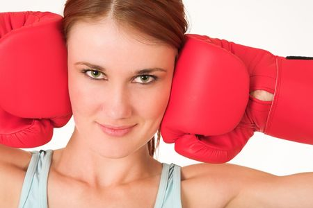 A woman in gym clothes, wearing red boxing gloves. Stock Photo - 467370