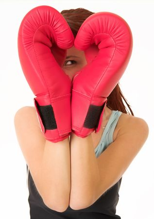 female form: A woman in gym clothes, wearing red boxing gloves. Stock Photo