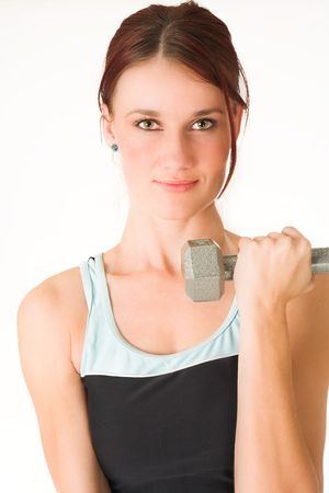 healthiness: A woman in gym clothes, training with weights Stock Photo