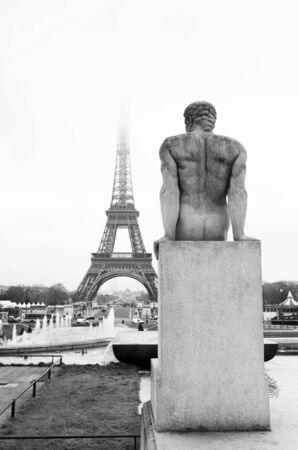 A statue in the foreground with the Eiffel Tower in Paris, France in the background.  Copy space. Stock Photo - 488165