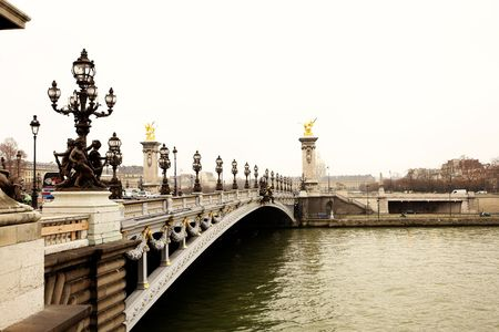 winters: Pont Alexandre III - Bridge in Paris, France.  Movement on cars driving � Gloomy winters day. Copy space. Stock Photo