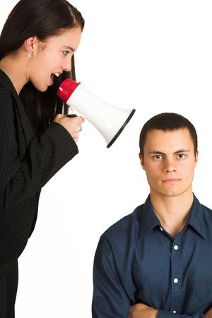 disregard: A brunette woman  yelling at her male business partner over a microphone. Stock Photo