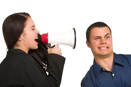 ignorant: A brunette woman  yelling at her male business partner over a microphone. Stock Photo
