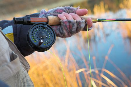 A fly fishermans spinner - Focus on spinner and line, Shallow DOF photo