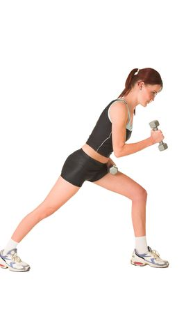 leaning forward: Woman leaning forward, looking down, working out with weights.