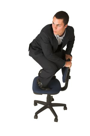 grand strand: Businessman wearing a suit and a grey shirt.  Making a stunt on an office chair Stock Photo