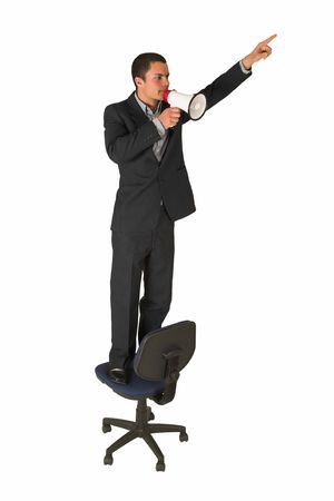 grand strand: Businessman wearing a suit and a grey shirt.  Making a stunt on an office chair with a megaphone in his hand, pointing upwards with the other hand.