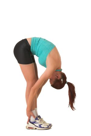 Woman streching, bending over.