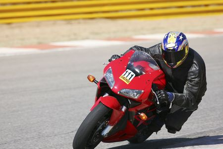 High speed Superbike on the circuit � Kyalami, South Africa � Movement on elements of the image. Trackday (all Logos and Trademarks removed)
