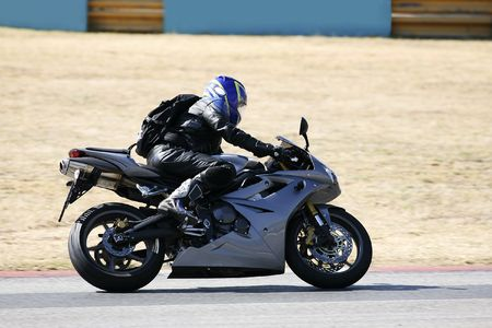 High speed Superbike on the circuit � Kyalami, South Africa � Movement on elements of the image. Trackday (all Logos and Trademarks removed) Stock Photo - 526579