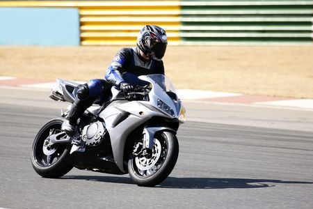 superbike: High speed Superbike on the circuit � Kyalami, South Africa � Movement on elements of the image. Trackday (all Logos and Trademarks removed)