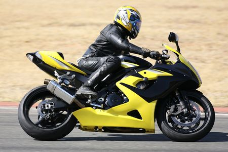 High speed Superbike on the circuit � Kyalami, South Africa � Movement on elements of the image. Trackday (all Logos and Trademarks removed) Stock Photo - 526529