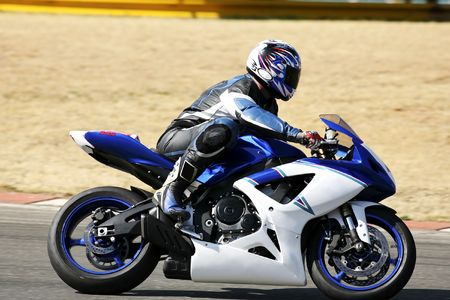High speed Superbike on the circuit � Kyalami, South Africa � Movement on elements of the image. Trackday (all Logos and Trademarks removed) Stock Photo - 526538