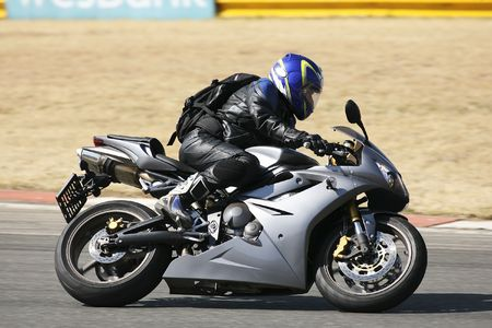 High speed Superbike on the circuit � Kyalami, South Africa � Movement on elements of the image. Trackday (all Logos and Trademarks removed) Stock Photo - 526551