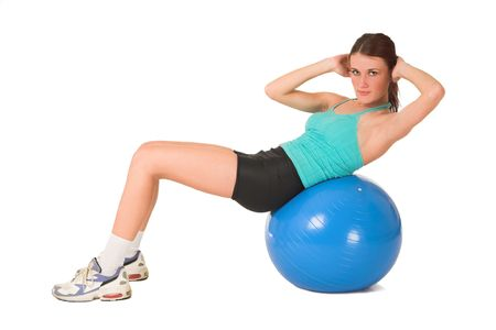 Woman working out on blue ball. photo
