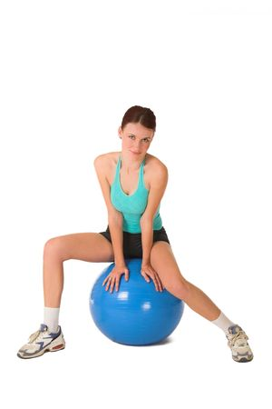Woman sitting on gym ball. photo