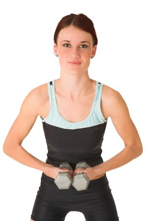 Woman standing with weights. photo