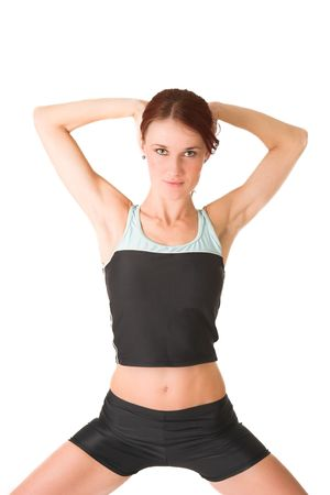 Woman standing with her hands behind her head. photo