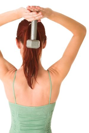 Woman holding a weight over her head. Stock Photo - 572259