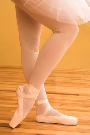 Woman doing ballet in dance studio