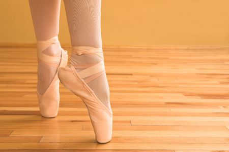 ballet shoes: Lady doing ballet in a studio.
