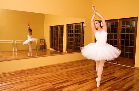 Lady doing ballet in a dance studio. Stock Photo