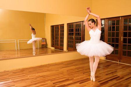 Ballerina dancing in a studio.