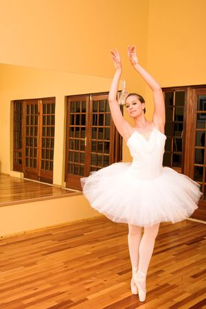 Ballerina dancing in front of a mirror photo