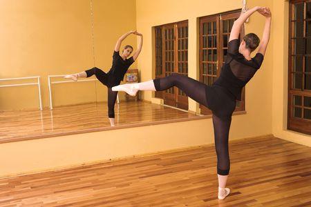 Ballerina dancing in studio Stock Photo - 591510