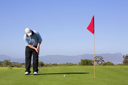 Man playing golf. Stock Photo