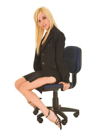 Blond business woman in small black dress photo