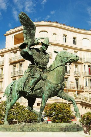 menton: Statues of the falconers in the public square at menton Stock Photo