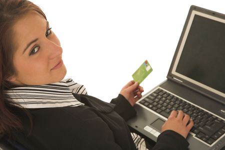 Woman on notebook computer with Credit Card photo