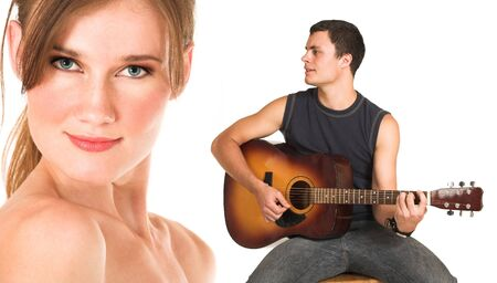 Close-up of the face of a beautiful brunette woman isolated on white. Young man in jeans and a t-shirt playing guitar and singing a song. Possibly lovers, implied  photo