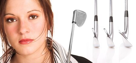 Businesswoman with brown hair, dressed in a white shirt with black stripes. Holding a golf club over her shoulder. Background has a row of professional golf clubs isolated on white. photo