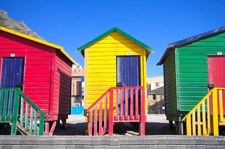 surfers: Multi-colored dressing rooms on the beach at Surfers Corner, Muizenberg, South Africa