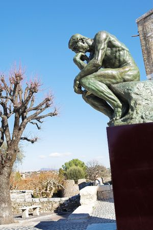 masterpiece: A copy of the famous bronze sculpture of Auguste Rodin – The Thinker (originally called  The Poet) in St Paul, France Stock Photo
