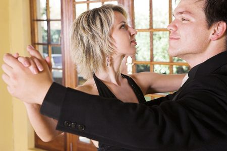 tango dance: A couple dancing together in a studio - Focus on Woman