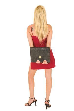 Blond business woman with black leather file in red dress photo