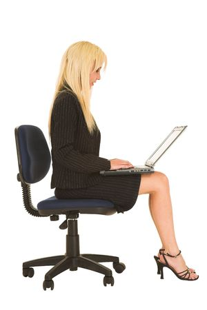 Blond business woman in black dress business suit, sitting down, with notebook computer on her lap Stock Photo - 827295