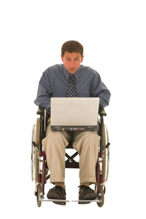 Man working on a laptop sitting in a wheelchair. photo