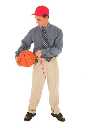 Man in a red cap, standing with basket ball and whistle. photo