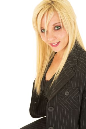 Blond business woman in black dress business suit photo