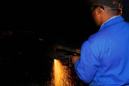 Worker in blue safety wear, working with Plasma cutter - Focus on person, not on sparks Stock Photo - 835737