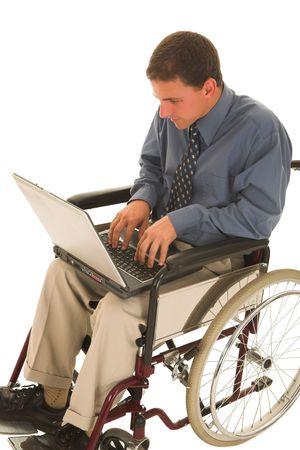 Businessman working on a laptop in a wheelchair photo