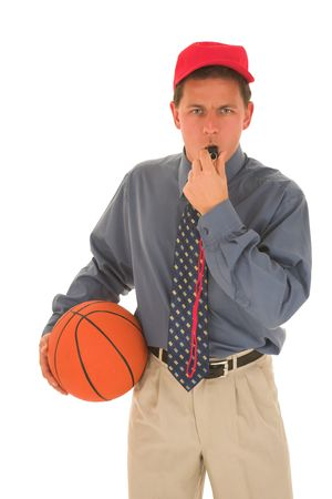 Man wearing a red cap holding, a basket ball and blowing on a whistle.  photo