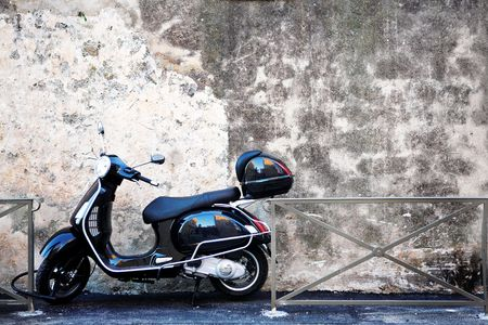 helmet seat: Scooter in front of a wall. Copy space.