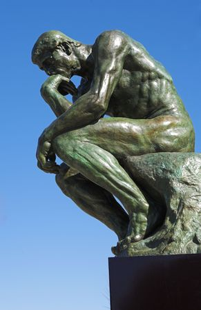 A copy of the famous bronze sculpture of Auguste Rodin – The Thinker (originally called  The Poet) in St Paul, France photo