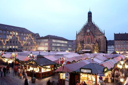 Flea Market at night in Neurenburg.  Movement on people walking. photo