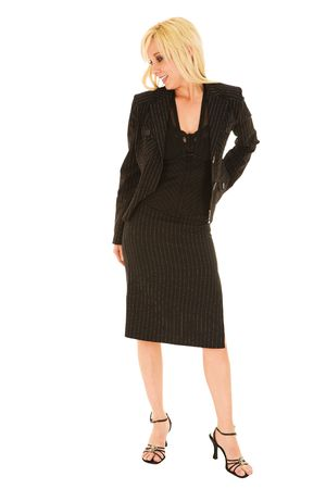pencil skirt: Full length image of a young blonde businesswoman in a formal black pinstripe suite with pencil skirt, isolated on a white background Stock Photo